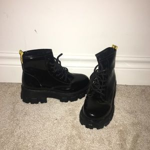 New worn black combat boots
